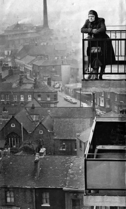 actress-violet-carson-on-a-balcony-looking-out-over-manchester-in-the-early-60s-photograph-by-john-c-madden